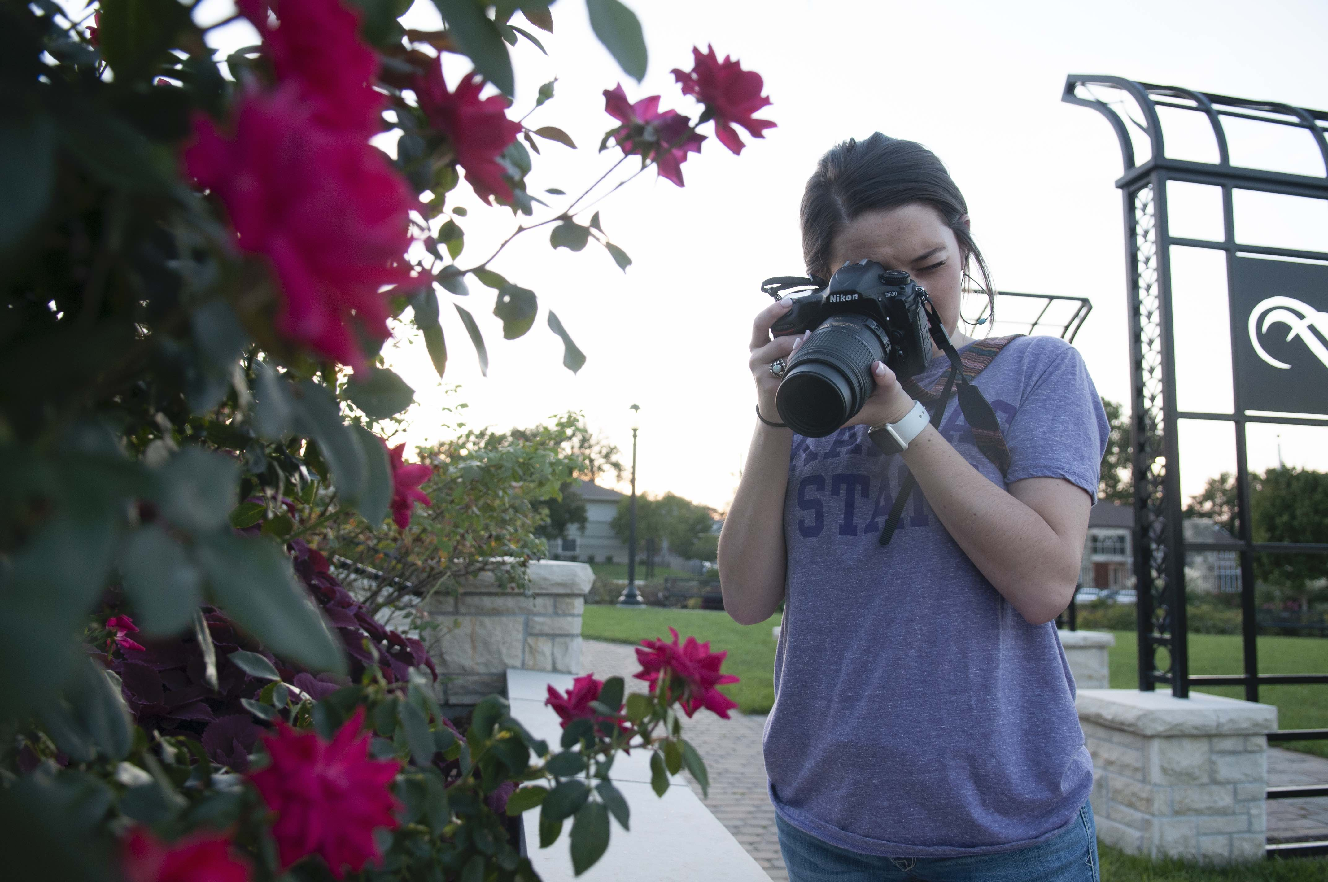Kyndall Hill taking a picture in the KSU gardens.